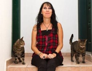 Barbara Buchner and her two pet cats Spider and Lugosi